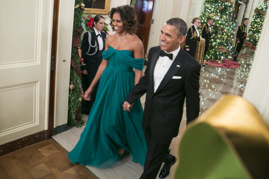 A hand-draped gown by Marchesa made for the perfect look to host the Kennedy Center honorees with President Obama. A delicate necklace and a box clutch completed the outfit.