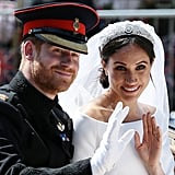 After the ceremony wrapped, Prince Harry threw on his military hat and a pair of white gloves for a carriage ride around the Windsor Castle grounds with his new wife. But they shared a romantic smooch on the chapel stairs first!