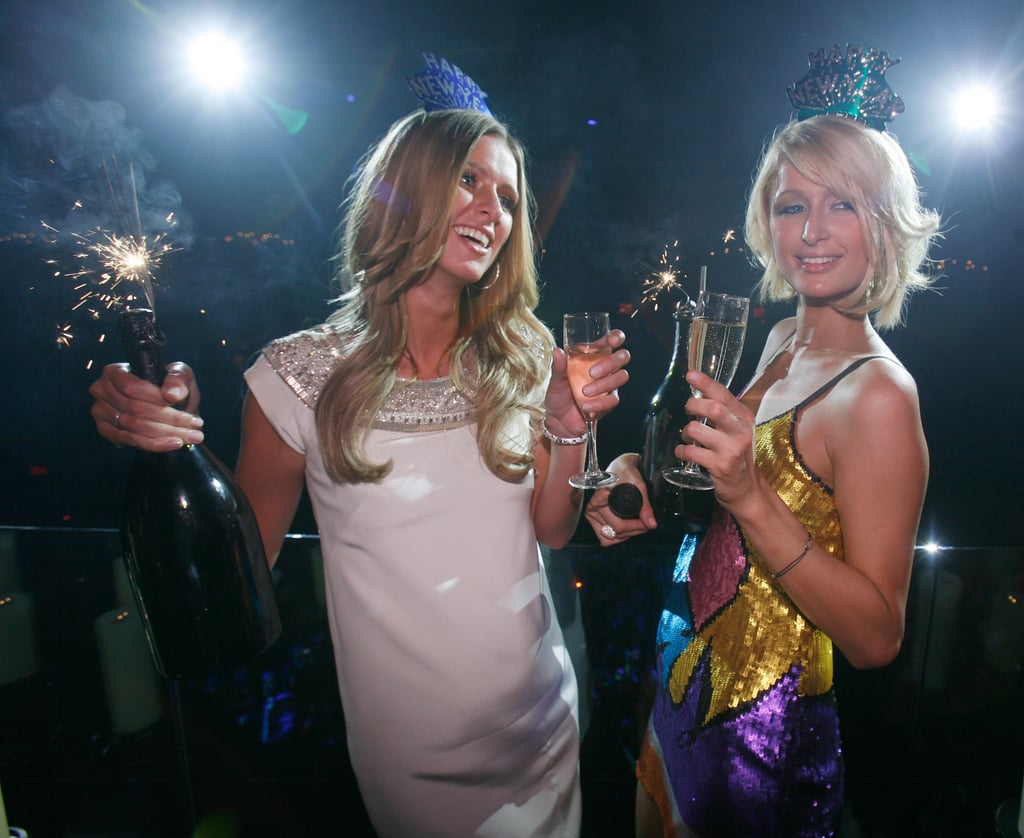 Paris and Nicky Hilton celebrated with Champagne and sparklers at a New Year's Eve party in Las Vegas back in 2007.