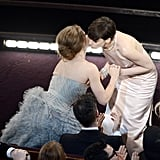 Anne Hathaway kissed Amy Adams as she accepted her award for best supporting actress at the 2013 Oscars.