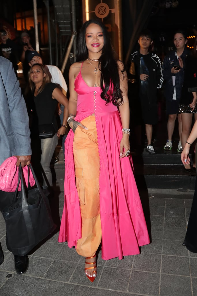 Rihanna Wearing Pink Dress Over Orange Pants in Seoul Korea