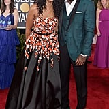 We can hardly blame her for trying to squeeze into this photo of Idris and his fiancée.