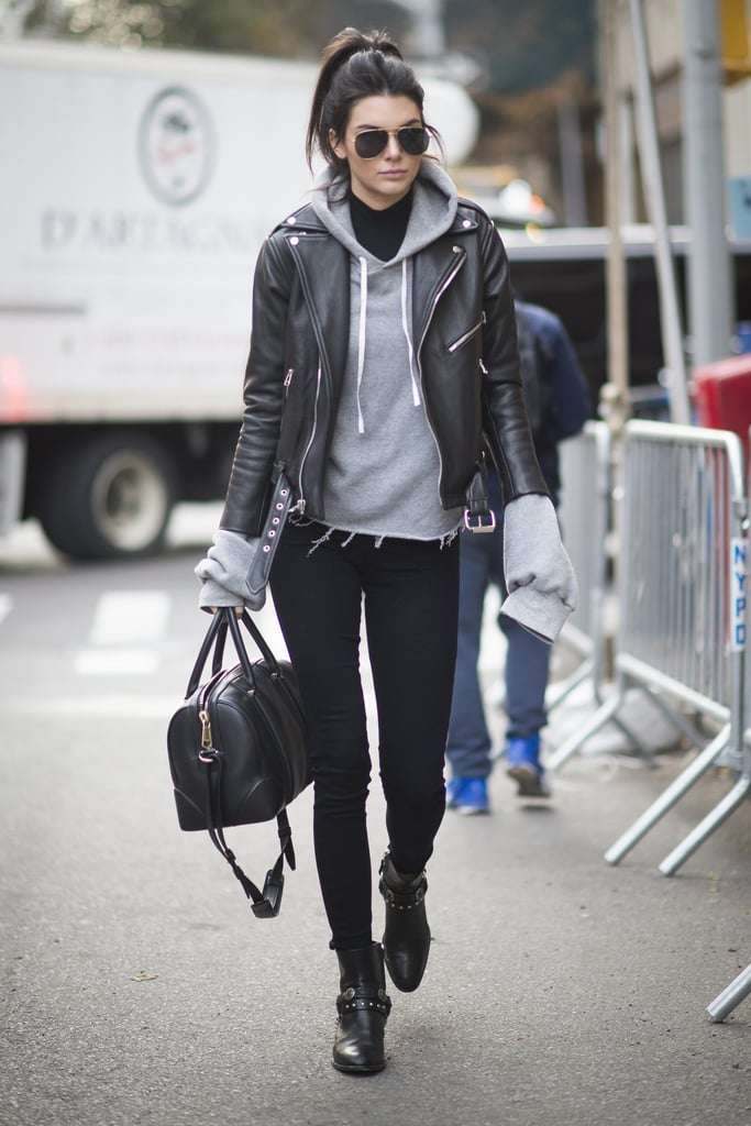 Kendall Jenner arrived at the show in an edgy yet casual street style look that included a frayed gray sweatshirt, leather jacket, and Paige black skinny jeans.