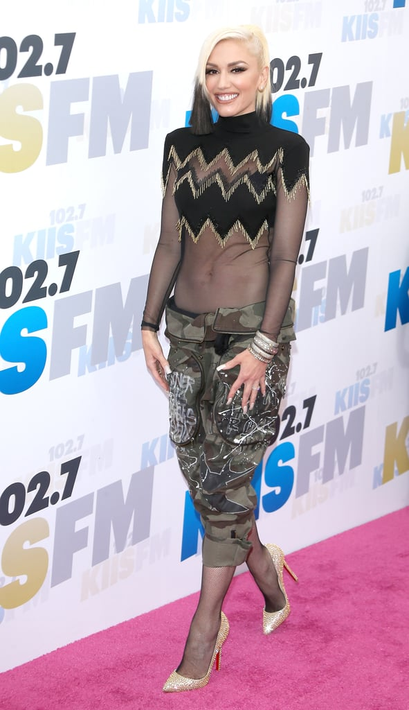 """Gwen Stefani was her usual cool self when she attended 102.7 KIIS FM's Wango Tango concert in Carson, CA, on Saturday evening. The singer, who was one of the performers at the event, gave fans a glimpse of her toned tummy in a sheer top while striking a bevy of fun poses on the red carpet. She also caught up with ET and opened up about her recent performance on The Voice with boyfriend Blake Shelton, saying, """"Anytime I've ever collaborated with anyone, it's always my favourite, but to do something with him — because he's so talented and comes from such a different world — to make music together, it was just so shocking! So amazing to do it live and share it with everybody."""" Keep reading to see more of her night, and then check out Gwen and Blake's cutest moments together."""