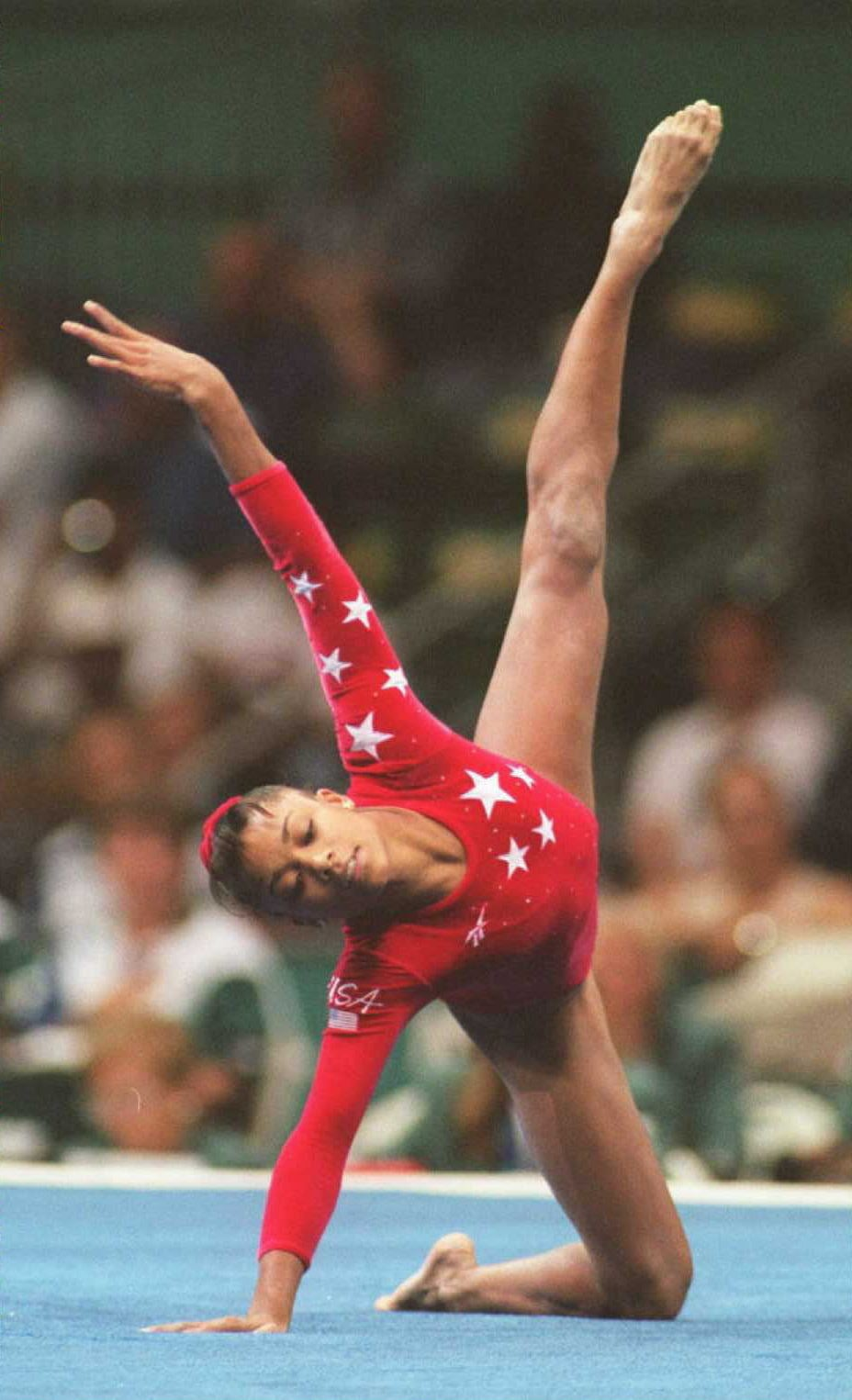 ATLANTA, GA - JULY 30:  Dominique Dawes of the US performs her routine in the Olympic individual floor event 29 July. Dawes took the bronze. (FOR EDITORIAL USE ONLY) AFP-IOPP/Eric FEFERBERG  (Photo credit should read AF/AFP via Getty Images)