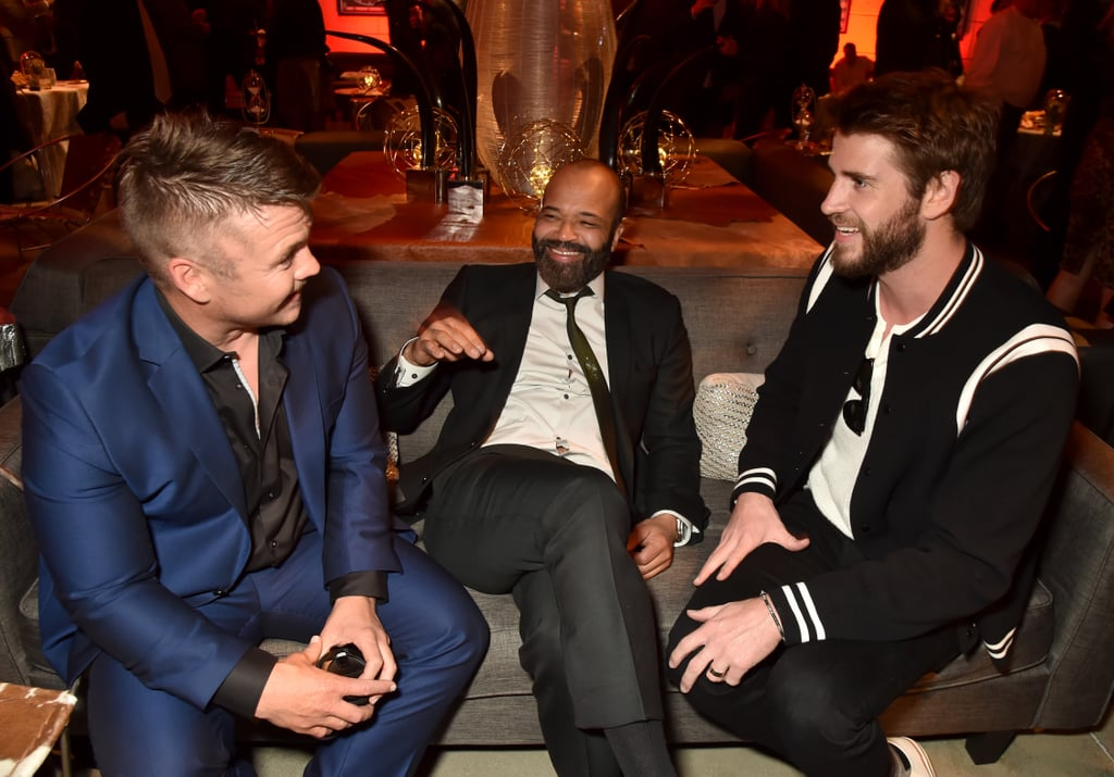 Westworld kicked off season two with a star-studded premiere in LA, and simultaneously made our favorite dystopian worlds collide. On Monday, Liam Hemsworth attended the event to support his older brother Luke (who plays Stubbs on the series) and ended up having a Hunger Games reunion in the process. After walking the red carpet together, the brothers caught up with their costar Jeffrey Wright inside. While the actor currently stars as Bernard Lowe on the HBO series, he is also known for portraying the equally tech savvy Beetee in The Hunger Games franchise. Seriously, imagine starring opposite not one, but TWO Hemsworth brothers!  Of course, this isn't the only Hunger Games reunion we've been blessed with recently. Jennifer Lawrence and Woody Harrelson, aka Katniss and Haymitch, caught up earlier this year when they shared a cute embrace during the Oscars. Seeing that Hollywood can't get enough of reboots, we think it's about time we head back to Panem.