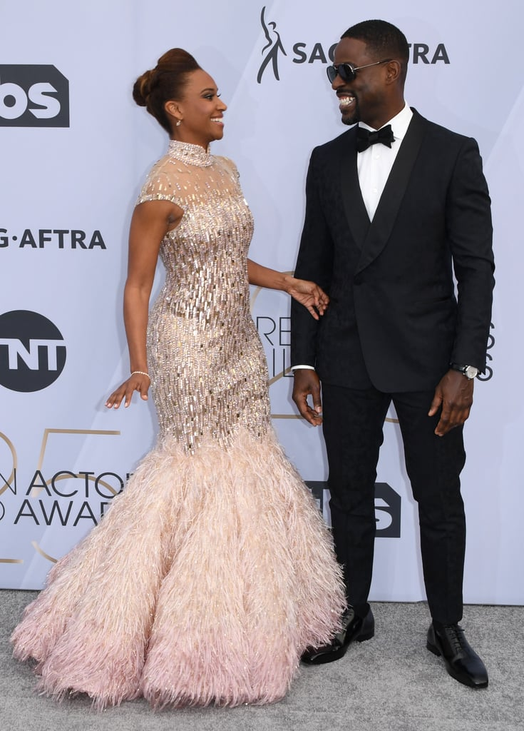 Sterling K. Brown and Ryan Michelle Bathe really know to pull at our heartstrings. On Sunday, the couple — who tied the knot back in June 2007 — attended the Screen Actors Guild Awards, where they shared one of the most heart-melting moments of the night. After This Is Us snagged the award for outstanding performance by an ensemble in a drama series, cameras panned to Sterling and Ryan in the audience as they celebrated the win with the coolest secret handshake. Between this and their adorable PDA on the red carpet, Sterling and Ryan are definitely giving Randall and Beth a run for their money!       Related:                                                                                                           The SAG Awards Was Basically a Family Reunion For the This Is Us Cast