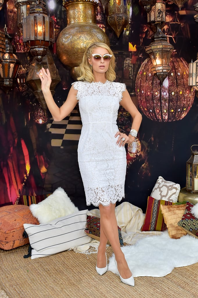 Paris Hilton wore a white lace dress and matching pumps.