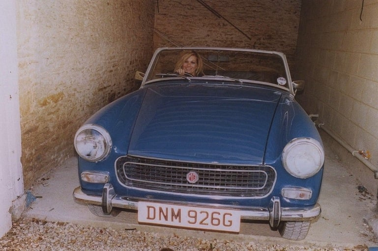 Taking her blue vintage car for a spin  | See Kate Moss