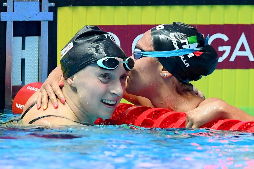 "To anyone watching the 2019 FINA World Championships, it was clear that Katie Ledecky wasn't her normal, dominant, five-time Olympic gold medalist self. The first clue came on July 21, when the 22-year-old swimmer lost the 400-meter freestyle, a race she's won in every international competition since 2013. Concerning, but everyone has bad races. Then she withdrew from the 200m and the 1500m finals, despite having the fastest qualifying time in the latter. Finally, US Swimming revealed that Katie was battling an unspecified illness with symptoms that included headaches, insomnia, nausea, and a lack of appetite. She would go on to spend seven hours at a hospital getting tested, followed by two days of bed rest. Katie herself later admitted that she felt so poorly during her 1,500 prelim that she almost got out of the pool with 400 meters left to go.  The 800-meter freestyle was Katie's final race at this ill-fated (literally) World Championships in Gwangju, South Korea. Going in, the gold was up for grabs; Katie's American teammate Leah Smith had bested her for the fastest qualifying time and Katie was sandwiched in the lane between her and Simona Quadarella, the Italian swimmer who had prevailed in the 1,500-meter in Katie's absence.  Katie started the race well, building a lead that stretched to nearly a body-length by the 300-meter mark. Yet as the laps wore on, that buffer shrunk and eventually disappeared as Simona surged ahead. When the swimmers turned for the last 50 meters, Katie touched just behind. But she shot off the wall in the final turn, made one final sprint home, and out-touched Simona by more than two seconds to take home her only individual gold of the meet. It was a demonstration of remarkable strength, grit, and stamina, and proof through sheer willpower, Katie could overcome severe circumstances. ""I had to dig really deep,"" said the swimmer, who joined the Built With Chocolate Milk campaign following her performance at Worlds. ""I did not feel very good when I dove in the water."" She accepted that her time wasn't going to break records, but that didn't mean she couldn't at least compete for the gold. ""I knew that I could really just blast out a fast last 50,"" she remembered. ""I just stayed calm in the race and just trusted that I could rely on my training and my speed to bring it home."" The hard-fought gold capped off perhaps the toughest meet of her pro career. ""It wasn't the week that I prepared for and the week that I was expecting to have,"" Katie told POPSUGAR. ""I had a really great year of training and so I was expecting to have a really great meet, but some things you just can't control and so I just dealt with the circumstances that I had to deal with."" And despite everything, she still came out of it with two silvers and a gold. Plus, as Katie told NBC Sports, the strides she made in that year of training don't just disappear because her meet didn't hit expectations. And if she can do that in an 800, after a week in and out of South Korean hospitals, well. . . suffice to say, Tokyo 2020 might be a sight to see. Keep reading for highlights and photos of the meet and Katie's incredible race."