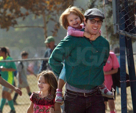 Slide Photo of Peter Facinelli Carrying Daughter to Soccer Game