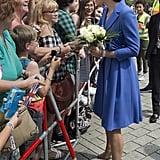 The duchess looks noticeably taller than many well wishers in Berlin.
