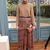 For Valentino, the style guru cinched a statement skirt and added a poloneck and boots for a perfect transitional look.