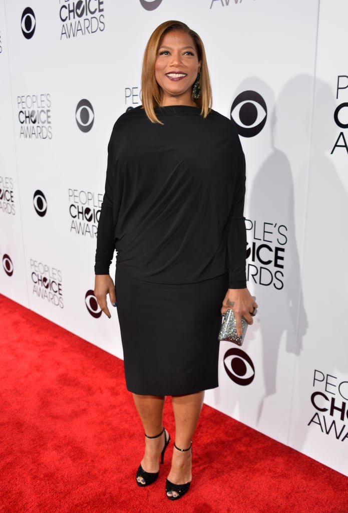 Queen Latifah wore a black dress and heels on the PCAs red carpet.