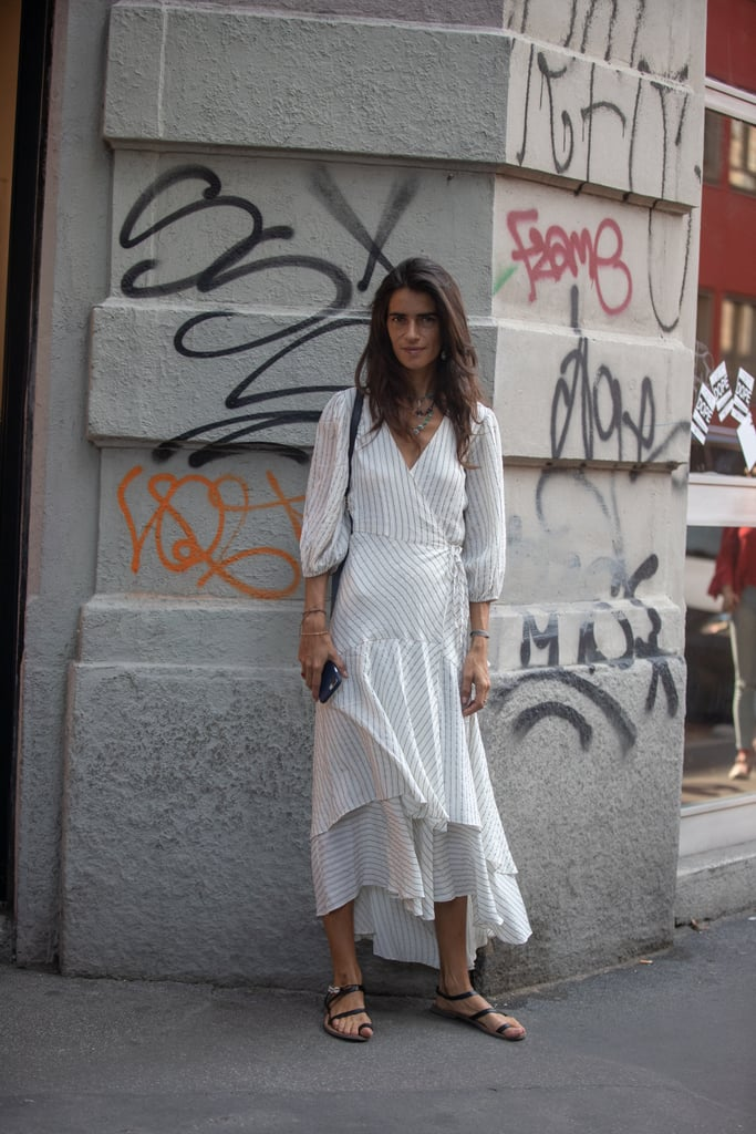 Pair a long-sleeved white dress with toe-loop sandals.