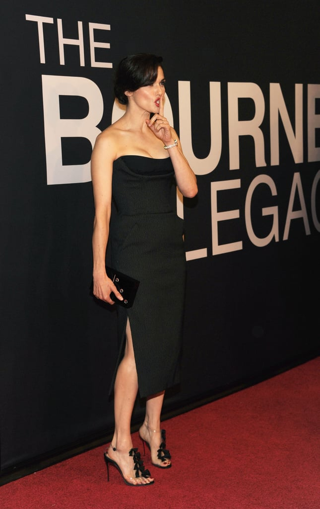Rachel's sleek black gown was accompanied with a Charlotte Olympia Pandora Domino clutch and a whimsical pair of Christian Louboutin Bow Bow sandals.