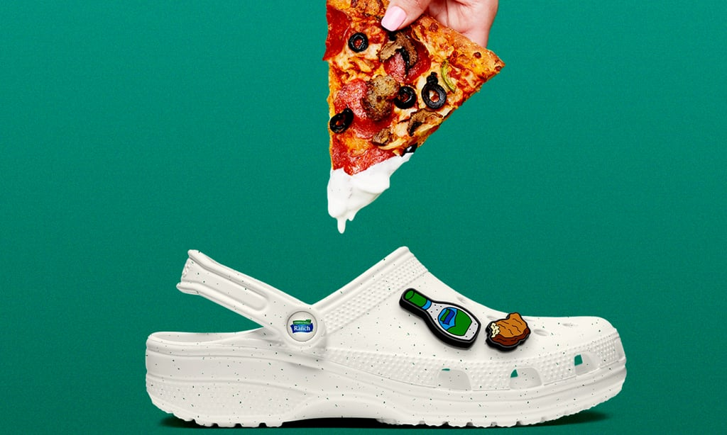 I really, really love ranch, but Crocs's latest collaboration has me wondering if I love it this much. The comfy-footwear company teamed up with Hidden Valley Ranch and streetwear brand The Hundreds to create a ranch-inspired version of its Classic Clog, and boy, did they deliver. The off-white Crocs have green speckles (yes, actually) and even come with Jibbitz shoe charms of foods you might dip into ranch, like chicken nuggets, pizza, veggies, and french fries.  Respectfully, I likely won't be copping these Crocs, but for those interested in wearing their favorite condiment on their feet, the presale is sold out, but they'll be available to purchase on Crocs's website later this year. Unlike the KFC Crocs, the Hidden Valley Ranch ones sadly (thankfully?) won't smell like their inspiration, but I guarantee ranch-lovers will still get a kick out of the clogs.  In celebration of the launch, Crocs, along with The Hundreds and Family Style Food Festival, will provide a monetary donation to the Independent Hospitality Coalition and donate 10,000 pairs of Crocs at Work shoes for restaurant-industry workers most impacted by COVID-19. Get a sneak peek of the, ahem, unique shoe ahead, and check back here for details on when it's coming to stores.      Related:                                                                                                           Crocs Is Reopening Its Free Pair For Healthcare Program After Donating $40 Million Worth of Shoes