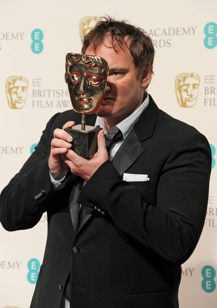 Quentin Tarantino played around with his BAFTA Award for best original screenplay in the press room.