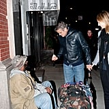 George Clooney and Stacey Keibler stopped to give money to a homeless man while out in Manhattan.
