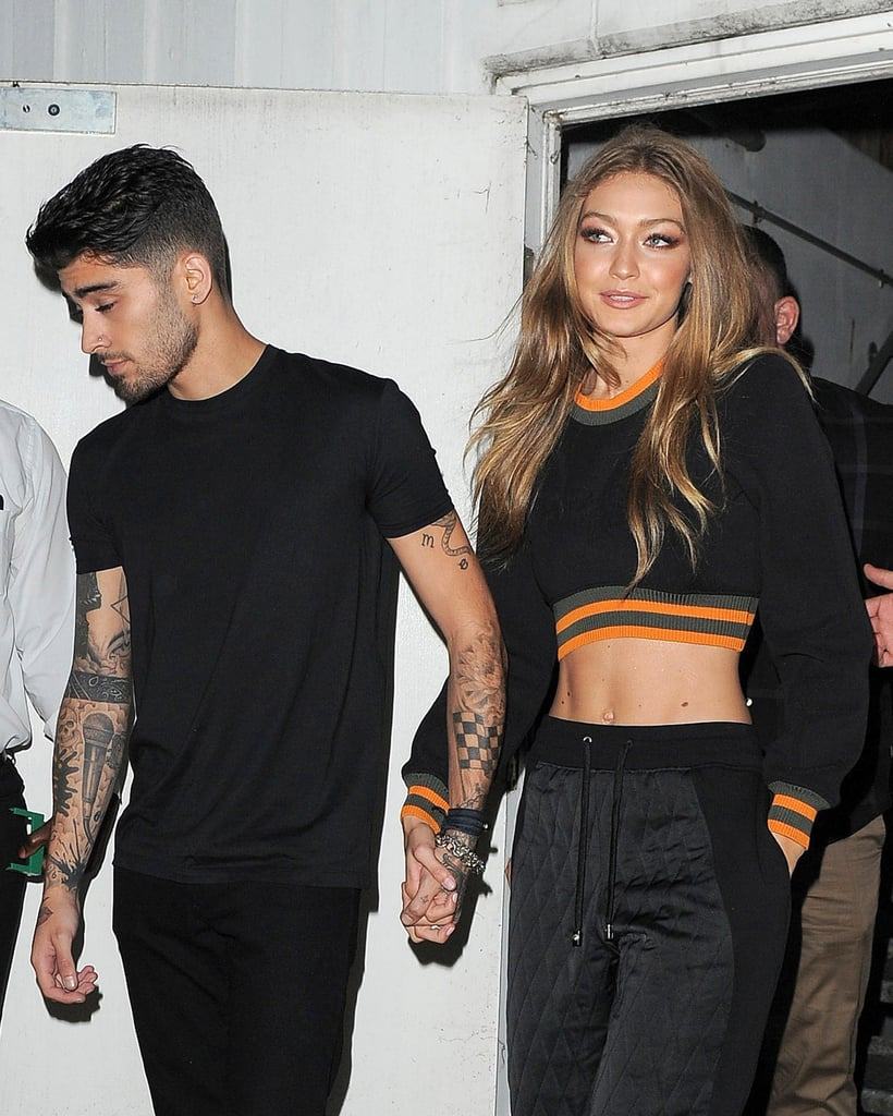 """Following her whirlwind week in NYC, Gigi Hadid jetted off to the UK with boyfriend Zayn Malik. The model, who's in town for London Fashion Week, was front row at the Versus Versace show cheering on her sister, Bella, as she strutted her stuff on the catwalk. Gigi and Zayn coordinated their looks in all black and were seen holding hands at the presentation. Bella made headlines earlier this week after she hit a snag while walking down the runway for Michael Kors. Although Bella calmly laughed off her fall and handled it like a pro, the front-row's reactions were pretty priceless. Still, the best moment may have been when Bella's boyfriend, The Weeknd, took to Instagram to congratulate her, writing, """"the best in the game 👌🏾."""""""