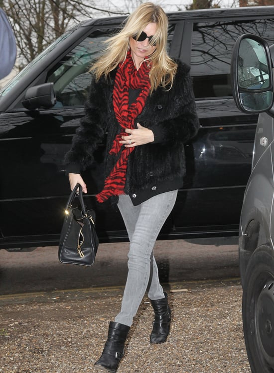 Pale grey skinnies are a Kate Moss trademark. Ankle boots and a scarf are the must-have accessories to go with them.