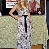 At a 2012 book signing, Lauren posed in a watercolor maxi dress. Lesson from Lauren: cinch your flowing dresses to create a sexier silhouette.