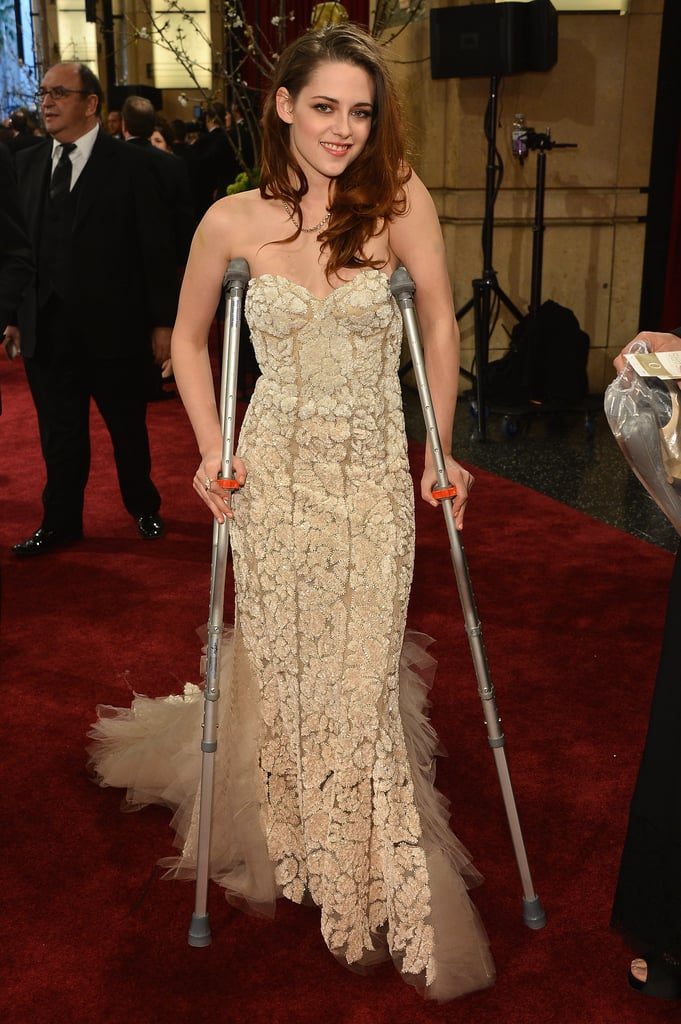 Kristen Stewart paired her Oscars gown with crutches on the red carpet in LA in February.