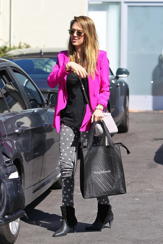 On her way into her office in Santa Monica, Jessica brightened her star-print denim and textured Rebecca Minkoff boots with a hot-pink blazer and pearl Michael Kors crossbody.
