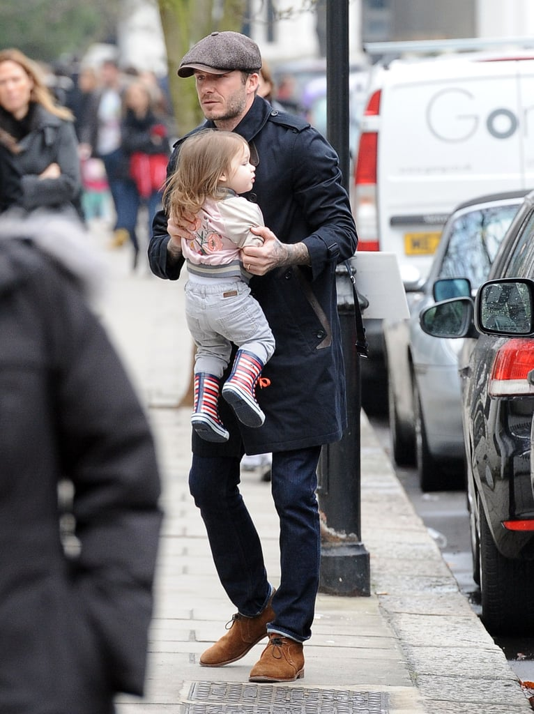 David Beckham put daughter Harper down on the sidewalk so she could show off her walking skills in London on Monday.