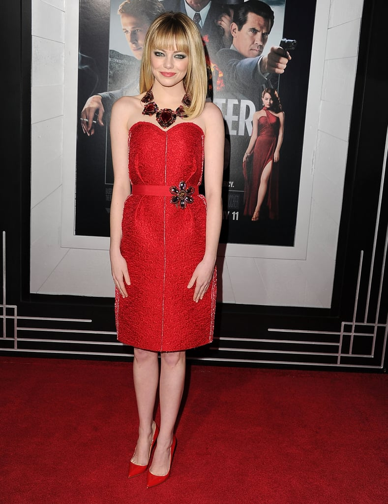 Emma Stone's fabulous red Lanvin getup was just what the Gangster Squad LA red carpet called for. Re-create this style with your favorite red dress, a statement necklace, and a jeweled belt.