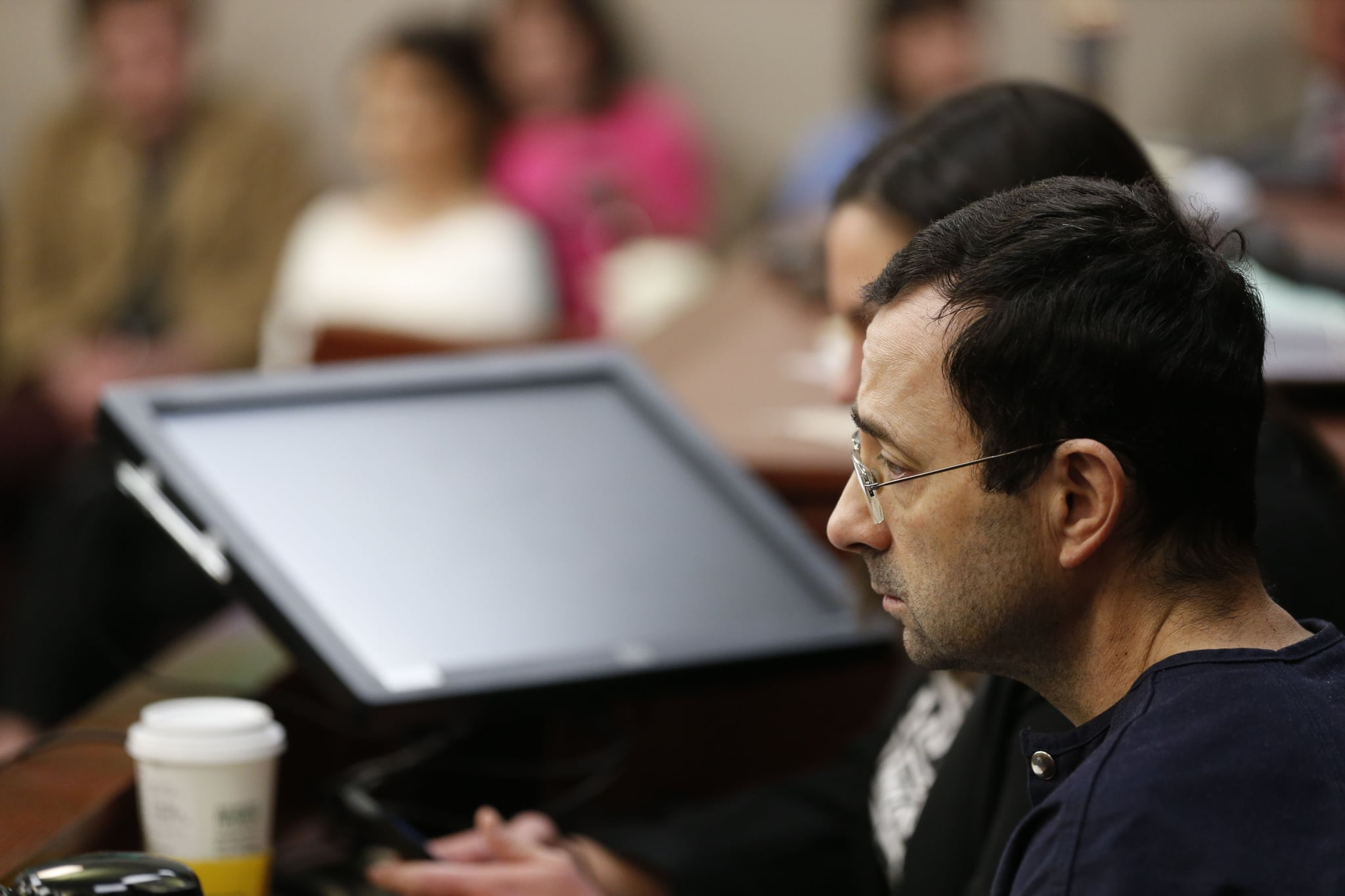 Former Michigan State University and USA Gymnastics doctor Larry Nassar gives an impact statement during the sentencing phase in Ingham County Circuit Court on January 24, 2018 in Lansing, Michigan.More than 100 women and girls accuse Nassar of a pattern of serial abuse dating back two decades, including the Olympic gold-medal winners Simone Biles, Aly Raisman, Gabby Douglas and McKayla Maroney -- who have lashed out at top sporting officials for failing to stop him.    / AFP PHOTO / JEFF KOWALSKY        (Photo credit should read JEFF KOWALSKY/AFP via Getty Images)