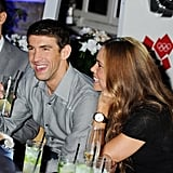 Michael Phelps laughed with Natalie Coughlin at a Spotlight on Swimming party in London.