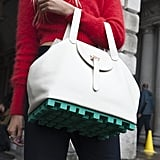 Are those legos on the bottom of her bag?