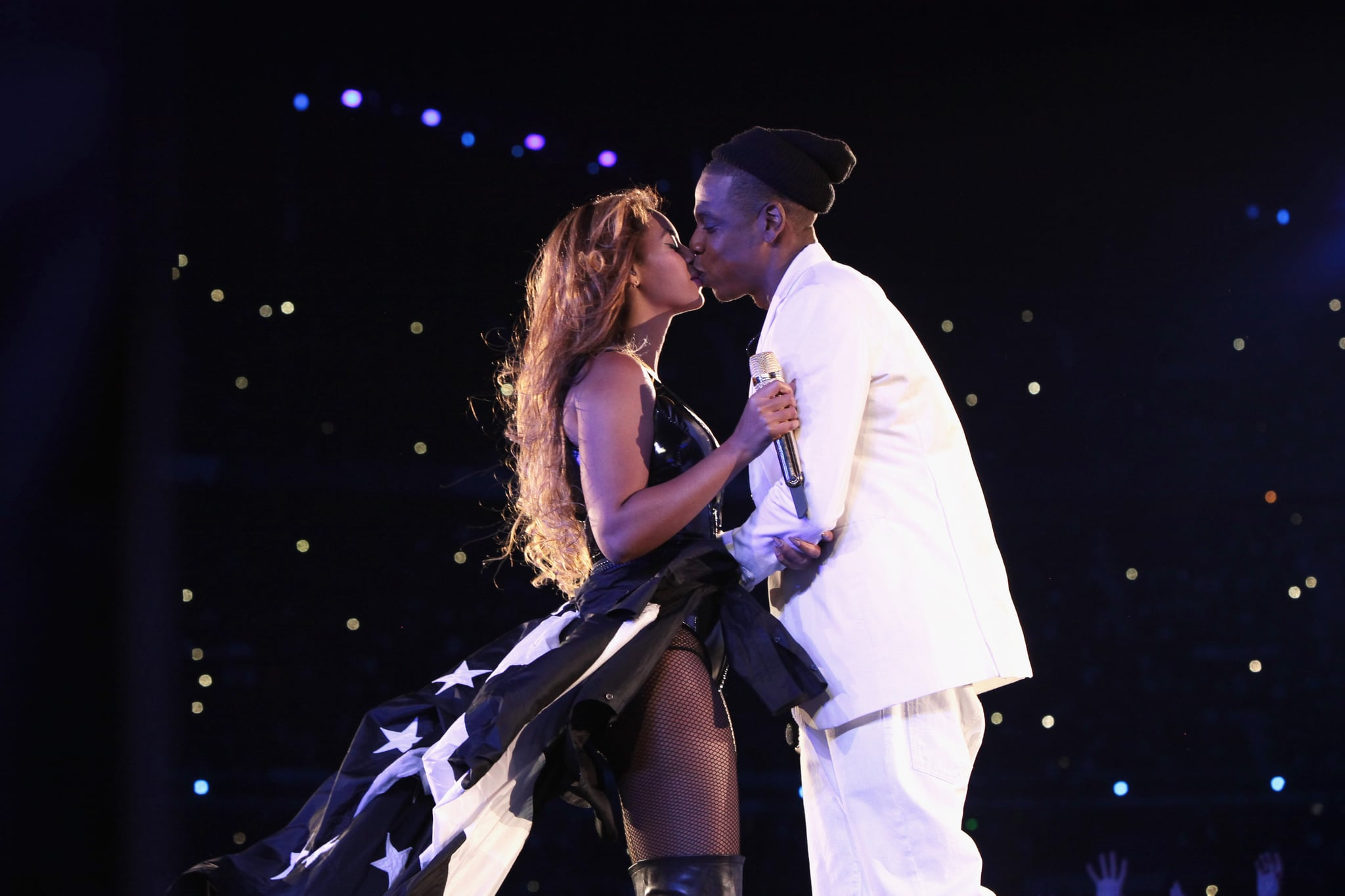 PARIS, FRANCE - SEPTEMBER 12:  Beyonce and Jay-Z kiss during the