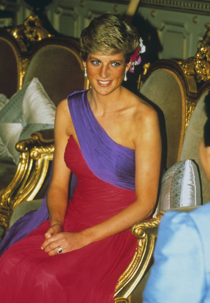For a dinner in Bangkok in 1988, Princess Diana pulled off a red and purple Catherine Walker gown.