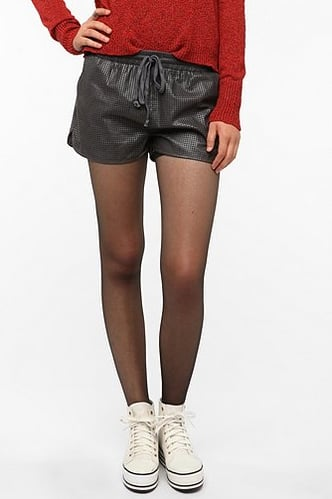The Lucca Couture Perforated Faux Leather Runner Short's ($30, originally $54) sporty take on leather was made for pairing with a slouchy sweater and high-tops.