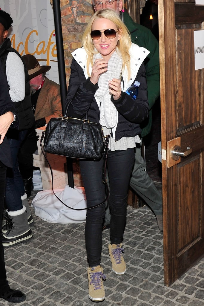 black and white Theory puffer coat and black Loewe satchel put a sleek polish on her laid-back attire.