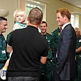 Prince Harry meets with ambulance crew members.