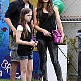 For a 2009 family outing in Venice, Kate went playful in painted Siwy jeans, nude Christian Louboutin pumps, and a fuchsia crocodile clutch.