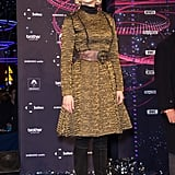 Kruger wore a brocade, metallic coatdress and leather tiger belt, both by Lanvin, with over-the-knee boots for a November 2012 event in Paris.