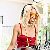 Kitty Cash wearing a red bustier and mirrored shades at the POPSUGAR Cabana Club pool party.
