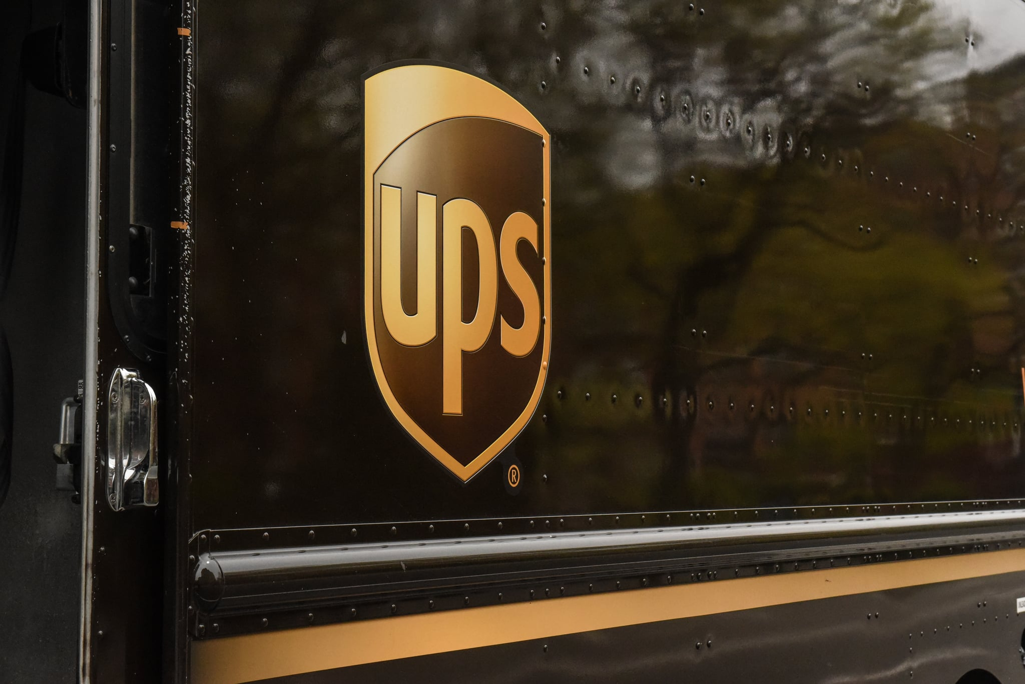 NEW YORK, NY - APRIL 29: A United Parcel Service logo is pictured on April 29, 2020 in New York City. Shares of United Parcel Service, UPS, dropped after the package delivery company reported their first-quarter earnings that fell below expectations.  (Photo by Stephanie Keith/Getty Images)