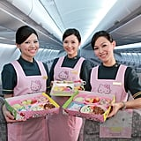 The flight crew aboard the Hello Kitty jet dons pink uniforms that feature the cute cartoon herself.