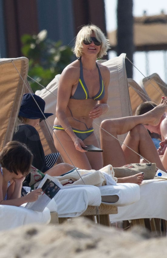 Cameron Diaz wore a bikini yesterday for an afternoon at the beach in Hawaii. She was surrounded by friends for the outing, which reportedly included a stint swimming with dolphins! In addition to showing off her amazing physique in the L*SPACE two piece, Cameron also debuted a platinum blond hair color and new cut.  She's starting 2012 with a new look, and possibly a fresh start in her love life. Despite a rumored romance with Diddy following her end-of-year split from Alex Rodriguez, Cameron rang in Jan. 1 without the rapper. Diddy was one of the many celebrities partying on New Year's Eve, and he hosted a bash in Miami that brought out friends like Rihanna and Gayle King. Alex Rodriguez had his own star-studded party in Cabo, where he mingled with pal George Clooney. George and Alex have even more to talk about now that they're both dating former WWE stars; George is going strong with Stacy Keibler, while Alex is dating Torrie Wilson.