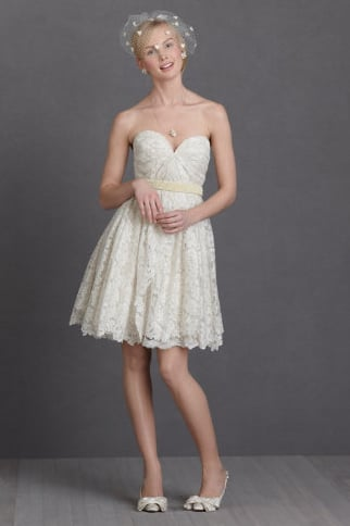 If you're drawn to sweeter styles, this pretty strapless boasts that utterly feminine sweetheart neckline and lace overlay. Its shorter length is ideal for a more casual setting or day wedding.  BHLDN Lustrous Lace Dress ($750)