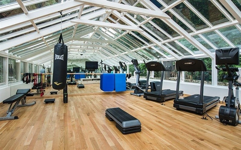 One of the greenhouses was converted into a sun-filled fitness center.
