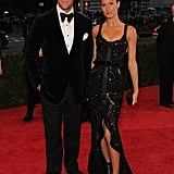 Gisele Bundchen posed with husband Tom Brady on the red carpet of the Met Gala.