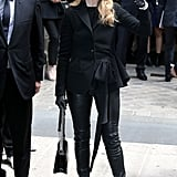 Dressed in chic black Dior for the Dior runway.