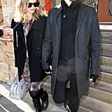 Kate Bosworth hit Sundance in a colorful printed dress topped with a black coat and finished off with black quilted boots and a Winter-white bag.