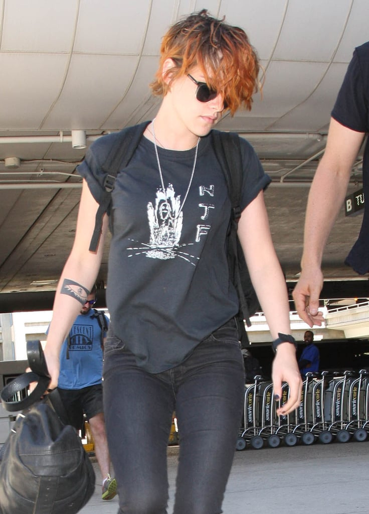 Kristen Stewart continued her busy travels with a flight out of LAX on Thursday. The actress showed off her new short haircut again while walking around the airport, which her stylist revealed was a last-minute decision made just two hours before she debuted it at the Chanel Haute Couture show a few weeks ago. Kristen has been all over the world in the past few months, flying to NYC for the Met Gala and then to France for the Cannes Film Festival in May, with trips home to LA in between. And her haircut isn't the only reason Kristen has been turning heads recently — she also dressed up in drag with Anne Hathaway and Brie Larson for a music video and showed off her sexy side in the new Clouds of Sils Maria trailer this month.